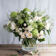 A classic and sophisticated monochrome, ivory toned arrangement. Romantic yet subtle, this elegant and gloriously scented and aromatic bouquet contains our finest white and ivory roses, freshly picked from either our sustainable English farm or Fairtrade Real Flowers, Cut Flowers, Bouquet Wrap, Flower Company, Ivory Roses, Valentines Flowers, David Austin Roses, Flower Delivery, Wedding Flowers