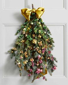 Ombre Jingle Bell Door Greenery DIY Project Recycle Your Christmas Tree | Martha Stewart Living _ Just because the holidays have passed doesn't mean you can't make it merry and bright