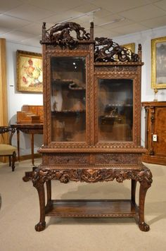 A Japanese Meiji Period Carved Cabinet On Stand C1880-1900