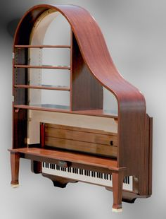 Repurposed a Baby Grand Piano  Had a client come into my shop as asked if I could make his Starck Baby Grand Piano into an entertainment shelf/bookcase.