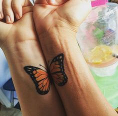 This mom and daughter decided on getting the monarch butterfly to honor the matriarch of their family -- Grandma. Each has a full butterfly tattoo, but they can also put them together like they did here. Love.