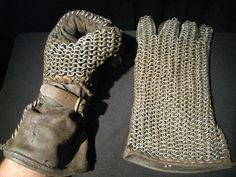 Mail Gloves: First pair made. Metal rings are woven into the leather of the glove but the thumbs are stitched, 5.5 lbs. for the pair.  - Made by David Bobrink