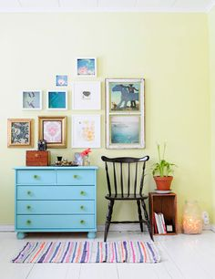 sweet little blue dresser...and I like the random pictures together.