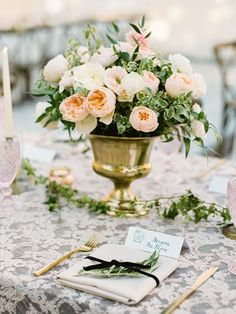 Romantic low wedding centerpiece with roses