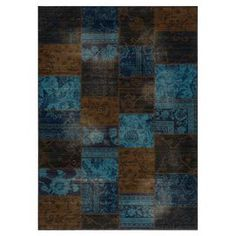 Hand-knotted New Zealand wool rug with an indigo patchwork motif.  Product: RugConstruction Material: 100% New Zealand woolColor: Brown and blueFeatures: Handmade in Egypt Note: Please be aware that actual colors may vary from those shown on your screen. Accent rugs may also not show the entire pattern that the corresponding area rugs have.Cleaning and Care: Professional cleaning recommended