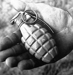 "Great photo! Look at the detail in the soldier's hand.....1938 US Mk2 ""pineapple"" grenade."