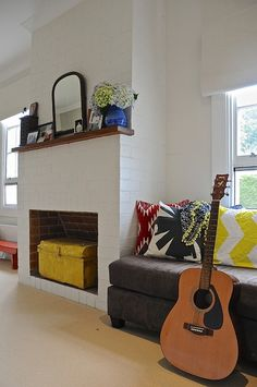 I like the idea of putting a chest in an unused fireplace.