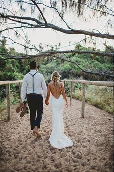The beautiful Jasmine wears the backless Poipu wedding gown by Katie May on her special day.