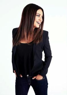 Mila Kunis...love her style, jeans with a blazer... More