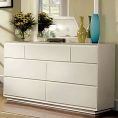 Bold and bright white, this modern bedroom dresser features ample storage, full extension glides and sleek modern lines. Material: Wood and veneers Contemporary