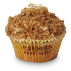 Apple Cobbler Cupcake from Crumbs. Apple cinnamon cake with apple preserves filling topped with vanilla cream cheese frosting and covered in streusel crumbs.