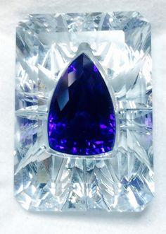 A tanzanite invisibly set in an aquamarine, by Glenn Lehrer and Jael Designs.