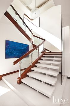 Contemporary White Staircase with Globe Pendants - Luxe Interiors + Design Staircase Storage, Staircase Design, Staircase Ideas, Staircase Architecture, Interior Architecture, Stair Steps, Stair Railing, Stainless Steel Balustrade, White Staircase