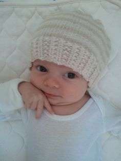 Newborn Knitting Patterns Baby Landon is finally wearing one of his new hand-knit hats! I especially love how soft this hat is… Newborn Knit Hat, Newborn Hats, Baby Hats Knitting, Crochet Baby Hats, Knitting For Kids, Knitting Projects, Hand Knitting, Knitted Hats, Booties Crochet