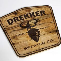A look at a sign we made for our friends at @drekkerbrewing . (Shoutout to @icsssupply for the wood)  #design #custom #signage #sign #reclaimed #salvage #wood #engraved #engraving #art #router #laser #signs