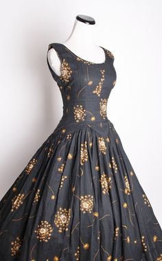 My goodness this is gorgeous! 1950s cocktail dress in gunmetal satin.