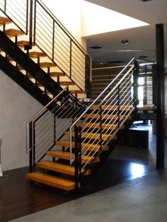 Kitchen, Staircase With Stainless Steel Stair Rails With Brown Laminate Floor Color: The Amazing Stainless Steal Backsplash