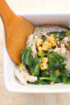 Chicken Salad with Buttermilk & Chive Dressing (1 1/2 cups Shredded chicken breast, 1 bunch/bag baby spinach, 1 cup sweet corn kernels, cooked (fresh or frozen)/ Dressing: 225ml buttermilk, 2 tbsp freshly chopped chives, 2 tbsp white vinegar, 1 tbsp low fat mayonnaise, salt and freshly ground pepper)