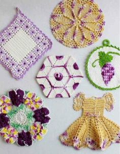 """Watch Maggie review these beautiful Vintage Purple Potholder Crochet Patterns! Edited By: Maggie Weldon Skill Level: Intermediate Sizes: Lantern - About 5½"""" wide, 6"""" point to point. Pansy - About 7½"""""""
