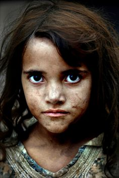 An Afghan refugee girl at a camp for displaced people across the border to Pakistan.