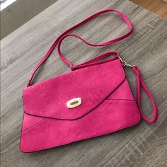 Pink crossbody/clutch bag Approximately 13 x 8 1/2 inches with an adjustable strap. Straps can also be detached Bags Crossbody Bags