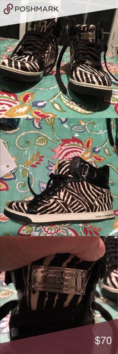 MK zebra print limited edition sneakers.Best offer Leather, rubber outsole, 373 out of 500 made.    Zebra print faux fur    Mi sign on front back and side of shoe Michael Kors Shoes