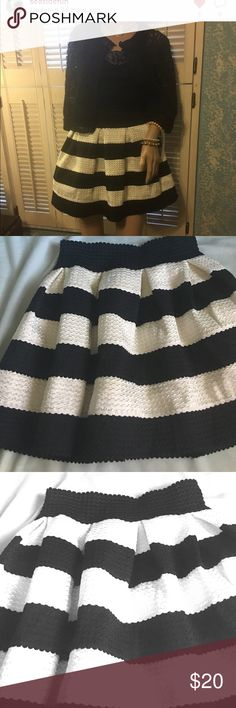 Mini skirt Black and white horizontal textured striped skirt with elastic band for comfort🎉 16.5 inches in length and 24 inch elastic waistband !!!!'the tank top and the lace jacket in my closet.🎉 L'Atiste Skirts Mini