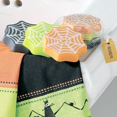 """Halloween Scented Spider Web Soaps (set of 3) by TAG. $11.99. 0.75"""" H x 3.125"""" Dia.. Crystal Soaps. Decorate your bathroom with our Halloween Scented Spider Web Soaps (set of 3). The set comes in three different colors, each with a different scent: orange/papaya scent; chartreuse/grape scent; charcoal/tropical fruit scent. Also consider our Halloween Critters Jacquard Guest Towels for a complete look."""