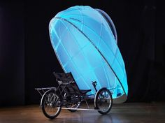 "Firefly trike, GeoSpace Studio, eco-friendly transport, green transportation, tricycle design, LED lights, human-powered vehicle, vehicle design, green design.... 'Wonder if this would ""blind"" you while you're driving it ?"