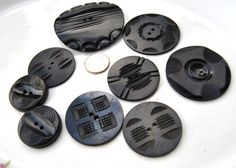 Antique Buttons Black Carved Wafers Celluloid Buttons Large Group of 9 L1472. $11.59, via Etsy.