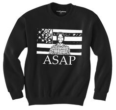 "This unique crewneck features an American flag with ASAP Rocky placed in the centre. The word ""ASAP"" is printed beneath the flag."