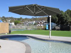 Pool Shade Ideas an in pool umbrella on the baja shelf of an inground swimming pool We Have Collected 20 Pool Shade Ideas To Help You Choose The Best Type For Your Swimming Pool It Is Most Natural When You Think Of A Swimming Pool