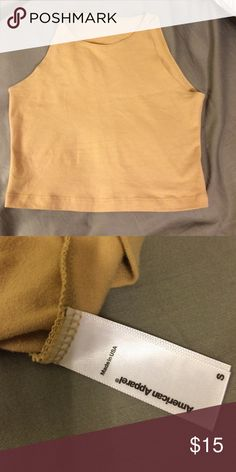 American Apparel Cotton Spandex Sleeveless Crop Tan AA Crop top. Wore maybe 3 times. Fits like an XS ..open to offers. ** American Apparel Tops Crop Tops