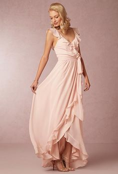 A ruffled, V-neck blush pink bridesmaid dress with a front slit | @ joannaaugust | Brides.com