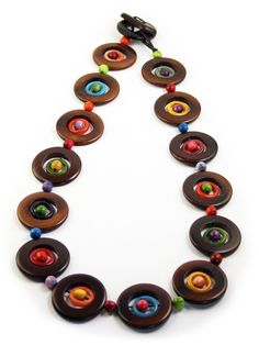 A concentric design and playful combination of shape and color give this necklace special character. Twelve inches long. This tagua necklace is fair trade and ethically handmade in Colombia using eco friendly dyes.