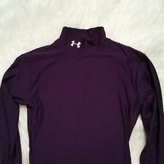 Under Armour Purple Lined Mock longsleeve In pristine, like new condition. This is the coldgear mock turtleneck shirt in rich purple. No snags or tears. Under Armour Tops Tees - Long Sleeve