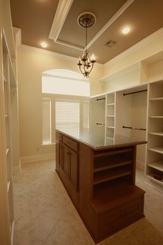 This walk in closet features shelves, drop down ceiling, and a center Island. Built and Faux Finished Island Top.