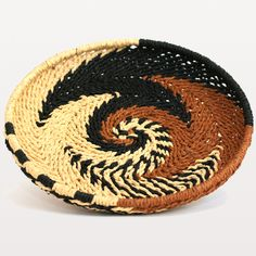 Swirly Wicker Tray: A lovely addition to any counter top this pretty hazelnut, black and natural swirled paper wicker tray by Madam Stoltz is an easy way to add texture and warmth to your home. This versatile piece can be used as a catch-all tray for trinkets and keys or for a nice stand for a plant.