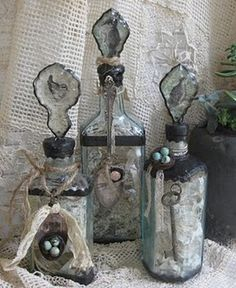 altered bottles with spoons and nests.
