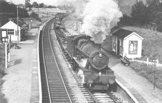 British Railways built 4-6-0 No 6995 'Benthall Hall' passes through Grimes Hill & Wythall Platform with a southbound mixed freight in 1964