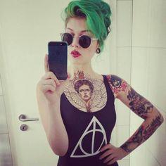 Green hair, tattoo chicks piercing