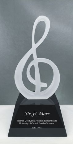 Sophisticated award with a stylish treble clef in frosted glass on top of a solid optic glass black base. An excellent choice for a command performance or an award to show the orchestra's appreciation to a fine conductor or music director. Engrave a few lines of text and custom logo or artwork to create a memorable gift.