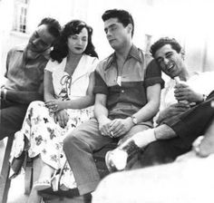 A lovely photograph of four Egyptian cinema stars. Kamal El Shinawy (far left) rests his head on Shadia's shoulder (both co-starred in numerous films), while leading man Shukri Sarhan (second from right) supports internationally acclaimed  director Youssef Chahine.
