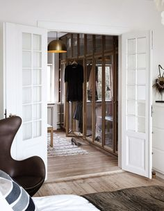 This is such a cool way of upgrading your existing #wardrobe #doors.  Have mirrors cut to fit the size of the exterior of the doors. Then simply fix a decorative or plain #wooden #frame or #beading all along the outer edges of those mirrors, with lovely new handles in place.