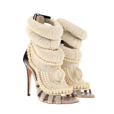 Giuseppe Zanotti.  OK, I am sure I have posted these about 100,000 times, but I can't get enough of them!  May be the coolest shoes in existence.