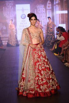Bridal Lehengas - Red and Gold Bridal Lehenga | WedMeGood | Crimson Red Gold Embroidered Lehenga with a Peach Blouse and a Beige Net Dupatta Outfit by: Shyamal and Bhumika #wedmegood #lehenga #indianbride #indianwedding #crimson