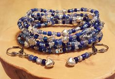 Check out this item in my Etsy shop https://www.etsy.com/listing/256529761/shaded-sapphire-blue-stretchy-seed-bead