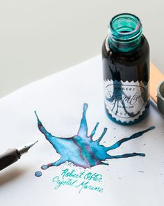 plastic bottle of Robert Oster Shake 'N' Shimmy shimmering fountain pen ink in the color Crystal Marine. Robert Oster Signature Inks are handmade in Australia. Fountain Pen Drawing, Fountain Pen Ink, Dip Pen Ink, Calligraphy Ink, Pen Collection, Stationery Pens, Pen Nib, Writing Instruments, Brush Pen