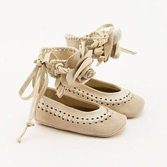 Beige leather baby shoes made from braided leather