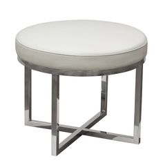 The Ritz Stool is a round padded stool that provides stylish additional seating and accents for any room of the home. Covered in a premium textured blended leather, it provides a perfect compliment to the artisan quality stainless steel base.